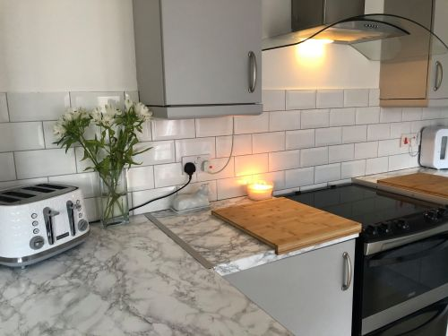Woman updates old-fashioned kitchen for just £80 using £5 marble wrap from B&Q