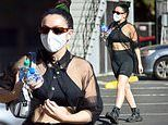 Charli XCX looks toned in sports bra and cycle shorts as she heads to dance studio in Los Angeles
