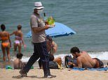 Holidaymakers should wear a mask EVERYWHERE as part of the 'new normal'