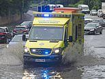 Flood warnings are issued across Britain after one month's worth of rain fell in just one day