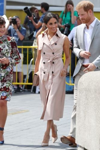 Meghan Markle trench dress: The Duchess of Sussex takes inspiration from sister-in-law Kate Middleton yet again as she wears pink trench coat by House Of Nonie to open the Nelson Mandela exhibit in London with Prince Harry