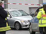 German police search home of driver who is arrested for attempted murder after ploughing into crowd