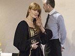 Florence Welch displays her boho fashion sense in a black and gold maxi dress for dinner in Rome