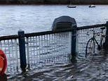 Silver soft top Audi TT is the victim of severe flooding after the River Thames bursts its banks