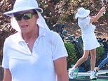 Caitlyn Jenner models her golf swing in a bright white ensemble while golfing in Westlake Village