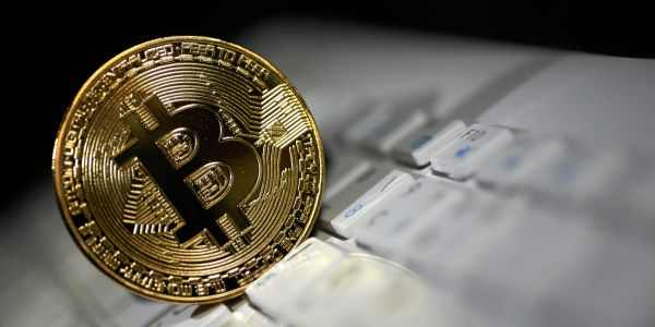 78% of institutional investors are not planning on investing in cryptocurrencies, though a majority say crypto is 'here to stay,' JPMorgan survey finds