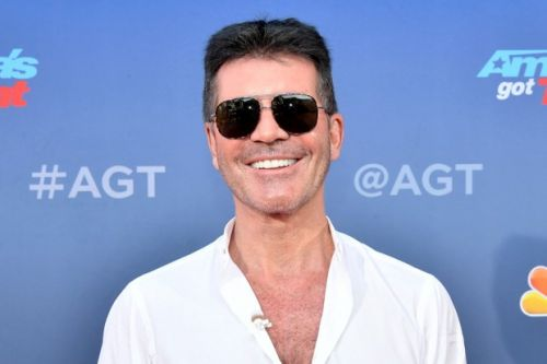 Simon Cowell in surgery after breaking back in electric bicycle accident