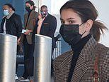 Kaia Gerber looks chic in a checkered blazer and black jeans after touching down at LAX