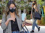 Jessica Alba mixes business with pleasure in jeans and a blazer as she heads to the office in LA