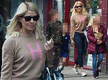 Holly Willoughby is chic as she enjoys a pub lunch with her family to mark end of lockdown