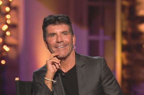 Simon Cowell rushed to hospital with broken back after falling off electric bike
