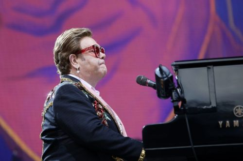Trooper Sir Elton John still plans to complete New Zealand shows after stopping gig due to pneumonia