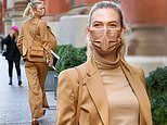 Karlie Kloss looks ready for business in a tan suit at a W Magazine board meeting in New York