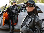 Kim Kardashian continues embracing her edgy side as she steps out rocking black leather trench coat