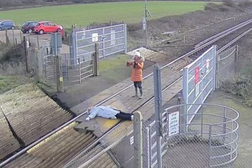 Women who posed for pics lying on railway track slammed as 'unthinkingly stupid'