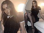Imogen Anthony debuts a gothic new look as she poses on a bed in raunchy hotel room photo shoot