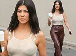 Kourtney Kardashian flaunts her figure in leather pants and ultra-sheer top as she sips on a coffee