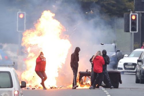 Furniture set on fire close to where bus torched in fresh Belfast protests