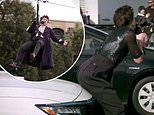 Harry Styles causes chaos by twerking on a car bonnet and getting stuck on a zip wire