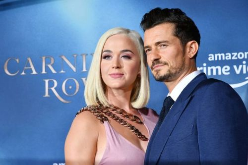 Sacha Baron Cohen says Orlando Bloom is Katy Perry's 'husband' in birthday clip