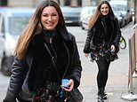 Kelly Brook looks lovely in a flirty floral dress and aviator jacket as she arrives at Heart radio