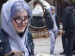 Kelly Osbourne continues to enjoy her slimmed down figure as she steals a kiss with beau Erik Bragg