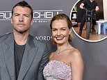 Lara Bingle's husband Sam Worthington chases their sons around mansion on a bike