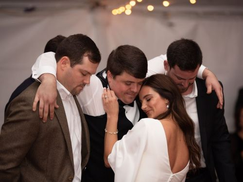 A paralyzed former baseball player danced with his wife on their wedding day thanks to some help from his friends