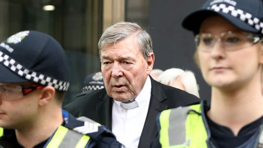 Cardinal George Pell walks free after shocking convictions overturned