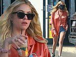 Ashley Benson teams silky orange blouse with Daisy Dukes as she picks up a coffee in Beverly Hills