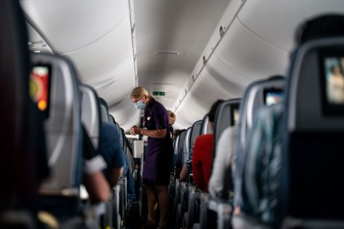 A flight attendant says she was too exhausted to report a passenger who shoved her when a flight was overbooked: report
