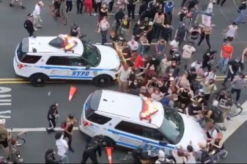 Police 'deliberately drive SUV into crowds' as protests rage across US