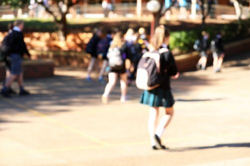 Schools are telling girls to wear shorts under skirts to stop 'upskirting'