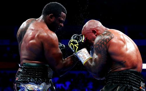 Dillian Whyte recovers from knockdown to beat Oscar Rivas in slug fest and become mandatory challenger to face Deontay Wilder