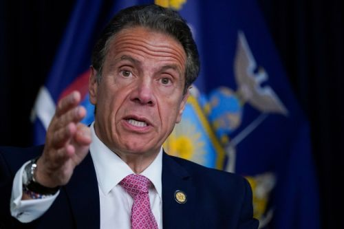 Ex-New York governor Andrew Cuomo charged over alleged groping of former aide