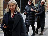 Molly-Mae Hague puts on a coy smile during stroll through Manchester with boyfriend Tommy Fury