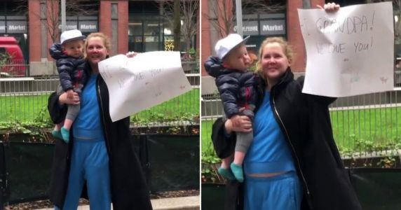 Amy Schumer and baby son take sign to dad's nursing home amid coronavirus lockdown