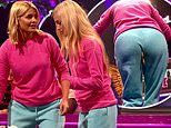 Holly Willoughby clenches her BUM as she tries to carry biscuits in her cheeks