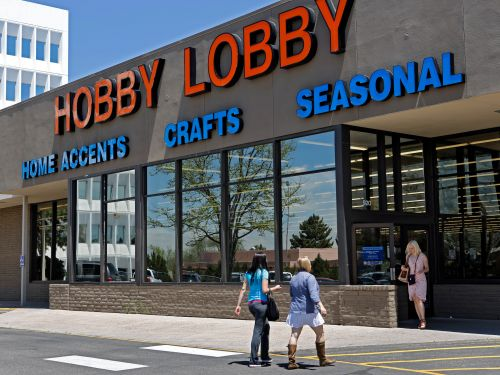Hobby Lobby is closing all stores and furloughing 'nearly all' employees without pay after it defied stay-at-home orders by quietly reopening locations around the nation