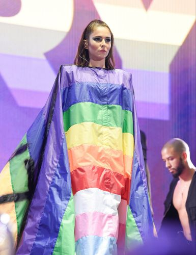 Cheryl drapes herself in rainbow flag as she vogues her way through Manchester Pride set