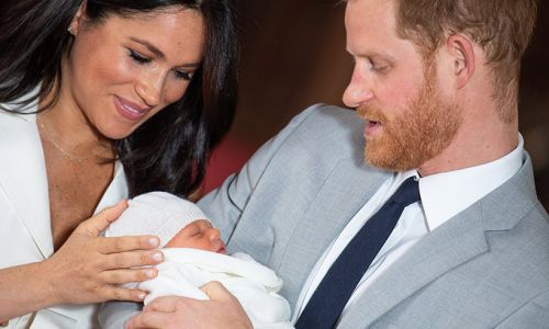 New photo of Prince Harry and Meghan's baby Archie revealed to be fake after fooling fans