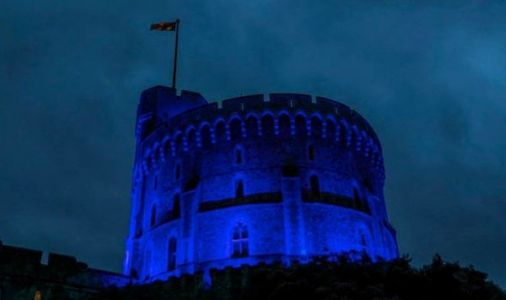 Queen lights Windsor tower blue as nation falls silent in poignant tribute to NHS workers