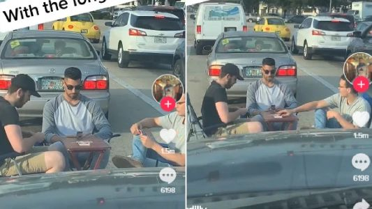 Traffic lights take so long to change driver sets up card table and plays while waiting