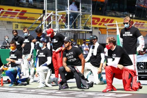 Lewis Hamilton reacts after six F1 rivals decline to take a knee