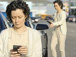 Sara Gilbert checks phone as she runs errands in LA. after filing for separation from Linda Perry