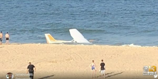 Tourists captured the moment a plane crash-landed onto the shore in a busy Maryland beach town