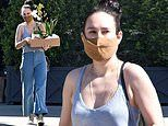 Rumer Willis models plunging top and throwback chic flared trousers as she picks up flowers in LA