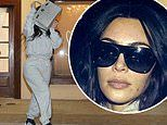 Kim Kardashian dons grey sweats as she hides behind purse after late night visit for hair removal