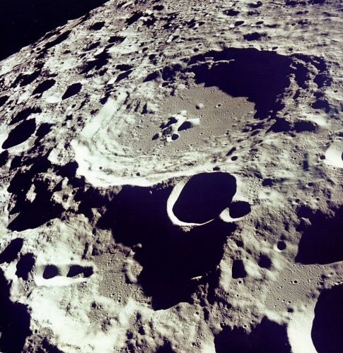 What date was the Apollo 11 moon landing mission launched and how far away is the moon?