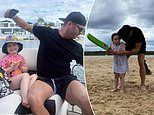 Michael Clarke teachesdaughter Kelsey Lee, 4, cricket as he holidays withPip Edwards